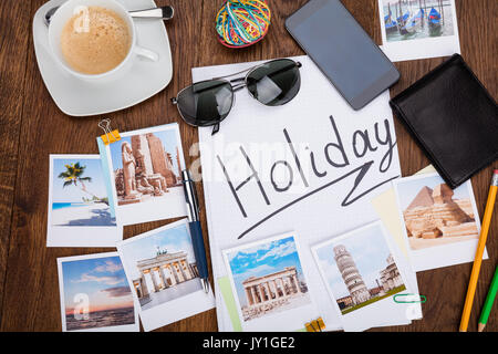 Photos Of Holiday On Wooden Desk With Sunglasses And Smartphone - Stock Photo