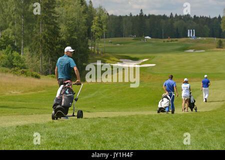 Tseleevo, Moscow region, Russia - July 24, 2014: Nikolaj Nissen of Denmark and other golfers on the golf course - Stock Photo