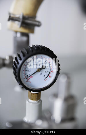 Closeup of pressure vacuum gauge with tube on background - Stock Photo
