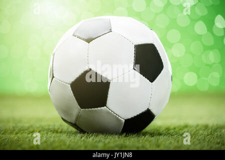 Close-up Photo Of Football On Grassy Field - Stock Photo