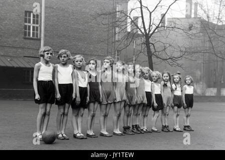 Girls standing in line waiting for Phys Ed class to begin. - Stock Photo