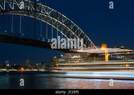 Cruise ship with Sydney Harbour Bridge at night. Sydney, New South Wales, Australia - Stock Photo