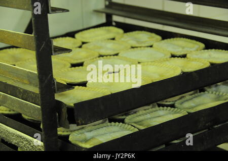 Food preparation at Cook's Pie and Mash shop, London. - Stock Photo