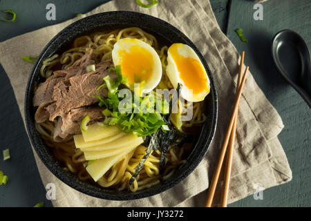 Homemade Japanese Pork Ramen Noodles with Egg and Seaweed - Stock Photo