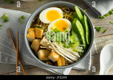 Homemade Japanese Vegan Tofu Ramen Noodles with Egg and Mushrooms - Stock Photo
