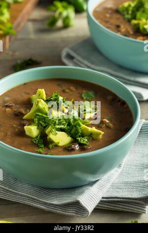 Fresh Homemade Black Bean Soup with Avocado and Cilantro - Stock Photo