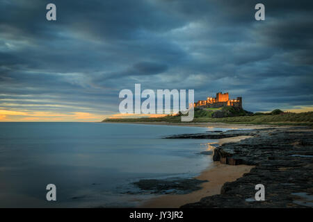 Bamburgh castle sunrise on the Northumberland coastline Stock Photo