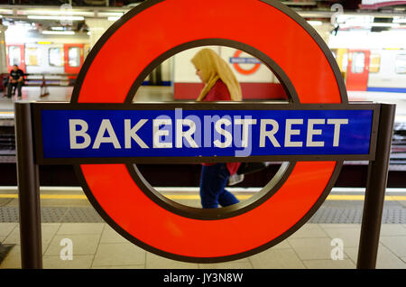A British Muslim woman travels through Baker Street Station, London - Stock Photo
