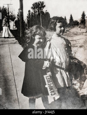 Youhg girls showing off their new clothes at the start of a new school year 1907 - Stock Photo