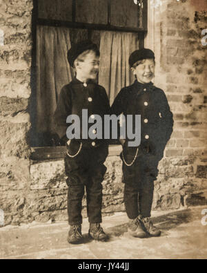 Youhg boys showing off their new clothes at the start of a new school year in 1907 - Stock Photo