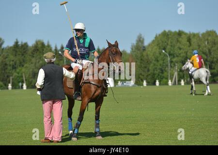 Tseleevo, Moscow region, Russia - July 26, 2014: Voice of British Polo Day Simon Ledger talks with Jamie Hepburn - Stock Photo