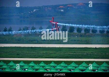 Shenyang. 18th Aug, 2017. Squadron members perform aerobatic flight during the 6th Faku Flight Conference in Shenyang, - Stock Photo