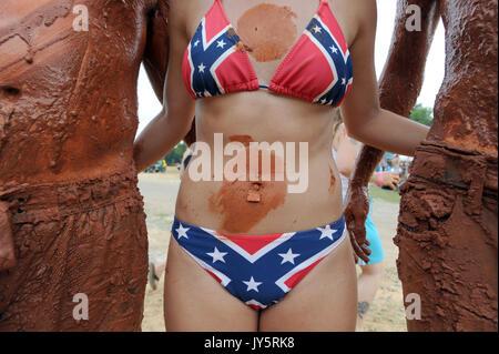 East Dublin, Georgia, USA. 11th Mar, 2008. Megan Lever sports a Confederate Battle Flag navel ring and bikini while - Stock Photo