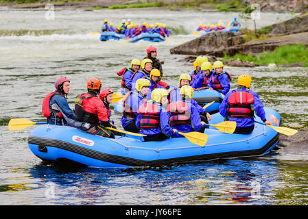 Byglandsfjord, Norway - August 1, 2017: Travel documentary of rafting group just after an adventure on the river. - Stock Photo