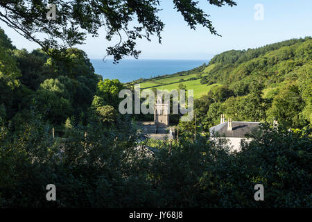 View of the village of Salcombe Regis, Devon, looking down the combe to sea, showing St Mary and St Peter's church. - Stock Photo