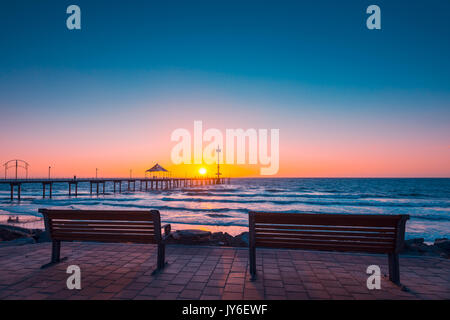 Brighton Beach view with people walking along jetty at sunset, South Australia - Stock Photo