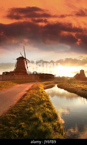 Traditional Dutch windmill in Zaanse Schans, Amsterdam area, Holland - Stock Photo
