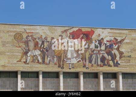Facade of The National Historical Museum in Tirana, Albania, with a mosaic telling about the revolution. named The - Stock Photo