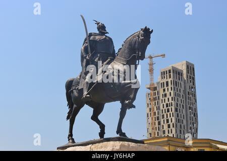 Tirana, Albania: Statue of Skanderbeg or Gjergj Kastrioti and the unfinished 4 evergreem building. On the Skanderbeg - Stock Photo