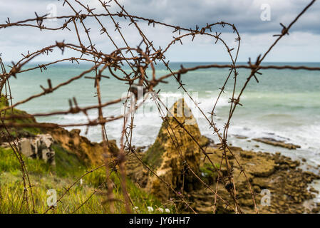 Remains of the German defences that were part of the Atlantic Wall in 1944 at Ponte du Hoc in Normandy - Stock Photo