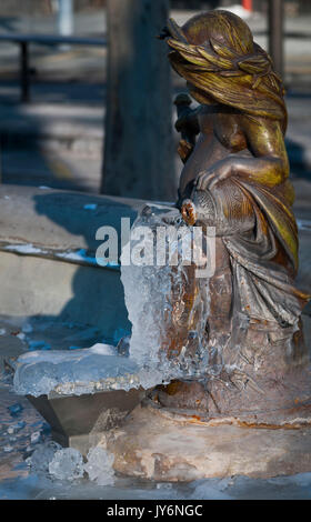 In winter, detail of a fountain covered with ice. - Stock Photo