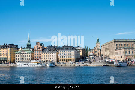 View towards historic Old Town of Stockholm from Skeppsholmen bridge with its Royal crown. The capital city of Sweden - Stock Photo