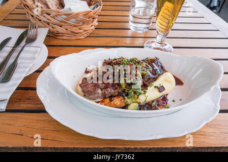 Shoemaker's box is a traditional Swedish dish consisting of beef served on mashed potatoes with gravy and garnished - Stock Photo