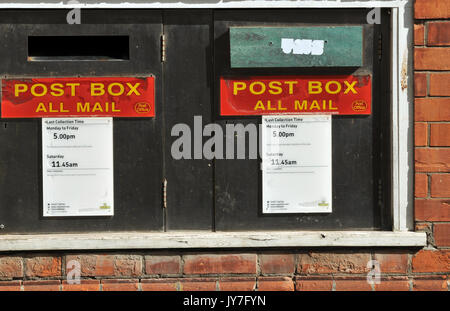 Post office signs and postal posting boxes at padstow post office in north cornwall. Collection times and red letter - Stock Photo