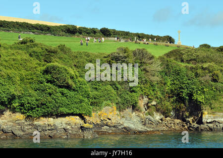 Visitors and tourists walking along the top of the cliffs and coastal footpaths at Padstow in north cornwall on - Stock Photo