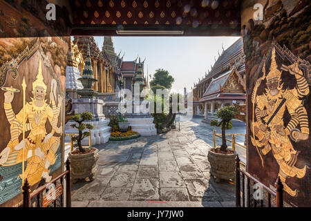 Ornate entrance door with gold decoration at Wat Phra Kaew Temple of the Emerald Buddha inside the Grand Palace, - Stock Photo