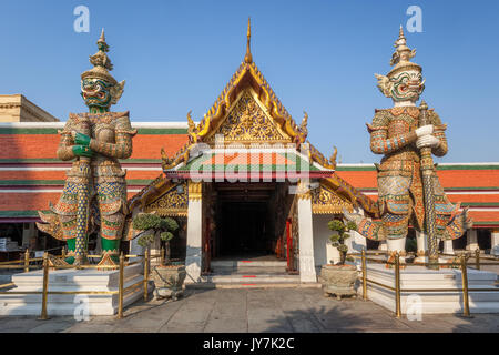 Demon Giant Guardians of Wat Phra Kaew, Temple of the Emerald Buddha inside the Grand Palace, Bangkok, Thailand - Stock Photo