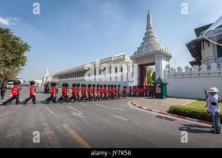 Royal Guards parading outside Grand Palace, Bangkok, Thailand - Stock Photo