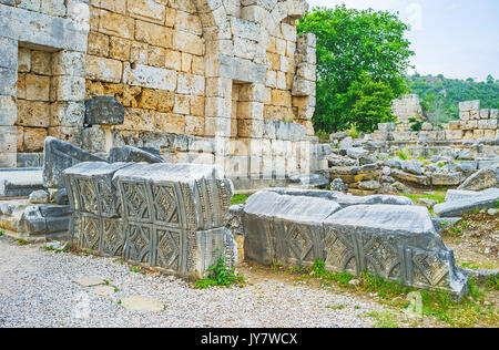 The carved patterns on the broken details of buildings in ancint Perge, Antalya, Turkey. - Stock Photo
