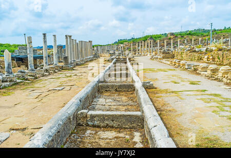 The ancient stone canal for water starts at the Nymphaeum fountain and stretches along the central city street, - Stock Photo