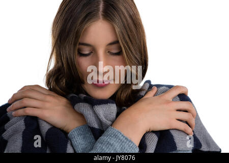 Close up of young woman covering with scarf against white background - Stock Photo