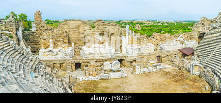 SIDE, TURKEY - MAY 8, 2017: The front wall and theatron of the ancient Greek Amphitheater, the pearl of the local - Stock Photo