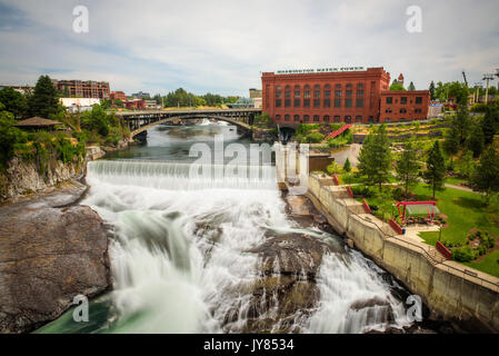 Falls and the Washington Water Power building along the Spokane river viewed from the Monroe Street Bridge, in Spokane, - Stock Photo