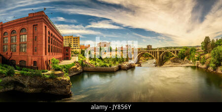 Panoramic cityscape view of Washington Water Power building and the Monroe Street Bridge along the Spokane river, - Stock Photo