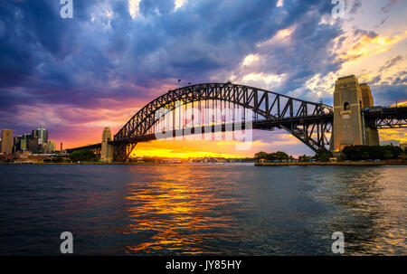 Dramatic sunset above Harbour Bridge in Sydney, NSW, Australia. - Stock Photo