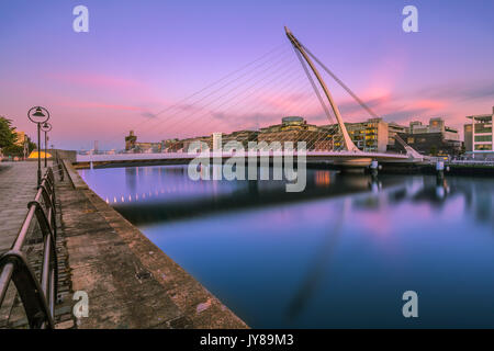 The Samuel Beckett Bridge is a cable-stayed bridge over the river Liffey in the docklands area in Dublin, Ireland - Stock Photo