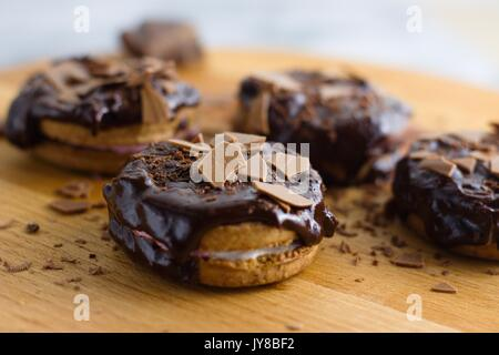 Cinnamon and marshmallow sandwich cookies topped by chocolate - Stock Photo