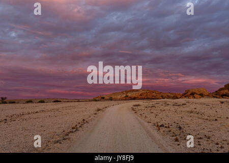Farm Wüstenquell (Wuestenquell Guest Farm): Sandy road in Namib Desert, after sunset, Distrikt Karibib, Namibia - Stock Photo
