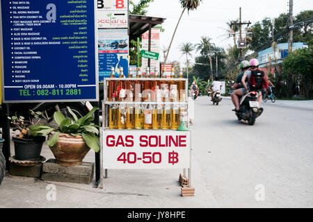 Ko Pha Ngan, Thailand - March 15, 2017. A small shop on the Ko Pha Ngan island selling bottles of gasoline. - Stock Photo