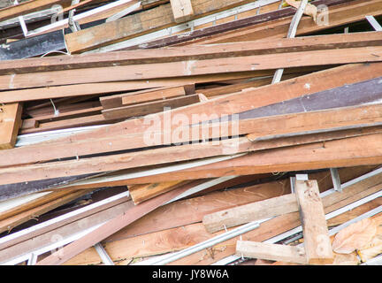 Large lumber pile from the broken house to preparation for renovation the old house. - Stock Photo