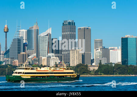 Sydney ferry in front of the city skyline. Sydney, New South Wales, Australia. - Stock Photo