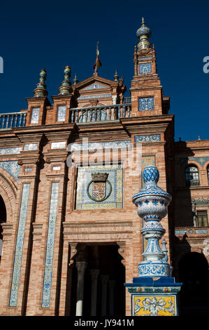 Spain: decorated buildings of Plaza de Espana, the most famous square of Seville built in 1928 for the Ibero-American - Stock Photo