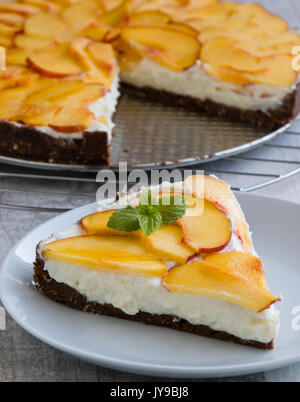 cheesecake dessert with thin slices of peach - Stock Photo