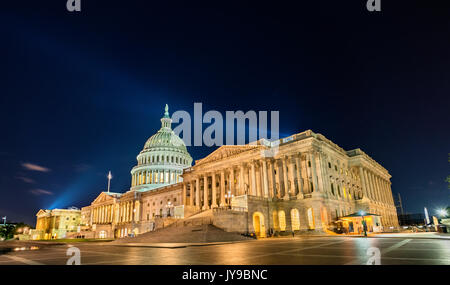 The United States Capitol Building at night in Washington, DC - Stock Photo