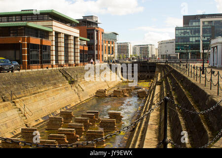The historic Clarendon dry dock basin in the Belfast Harbiour Estate at Donegall Quay - Stock Photo