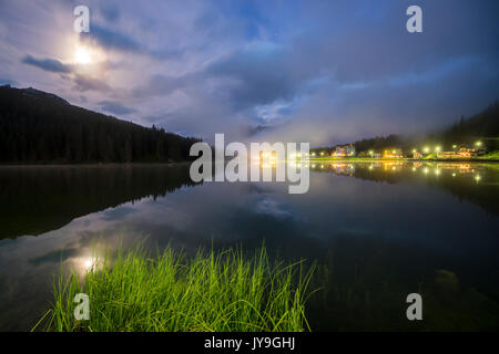 The full moon lights up the banks of Lake Misurina. Cortina d'Ampezzo. Dolomites. Veneto. Italy. Europe - Stock Photo